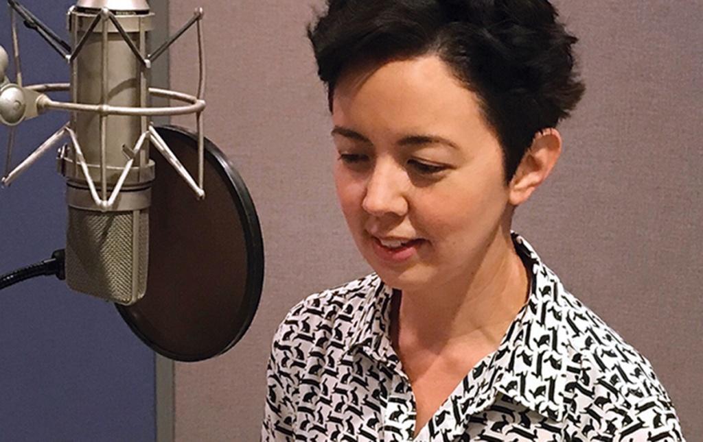 photo of Ellen Hendriksen '99 recording a podcast