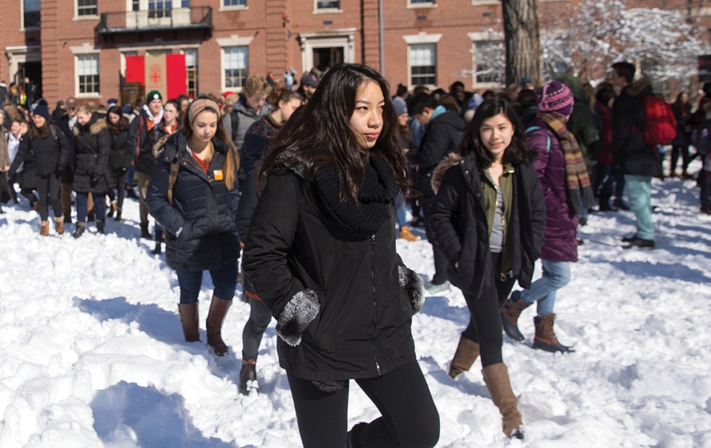 Photo of students protesting with a walkout on campus.