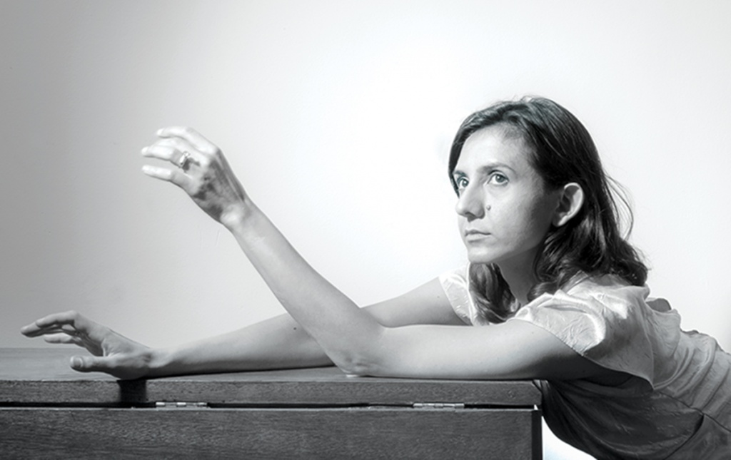 Black and white photograph of Ottessa Moshfegh '11 sitting at a table