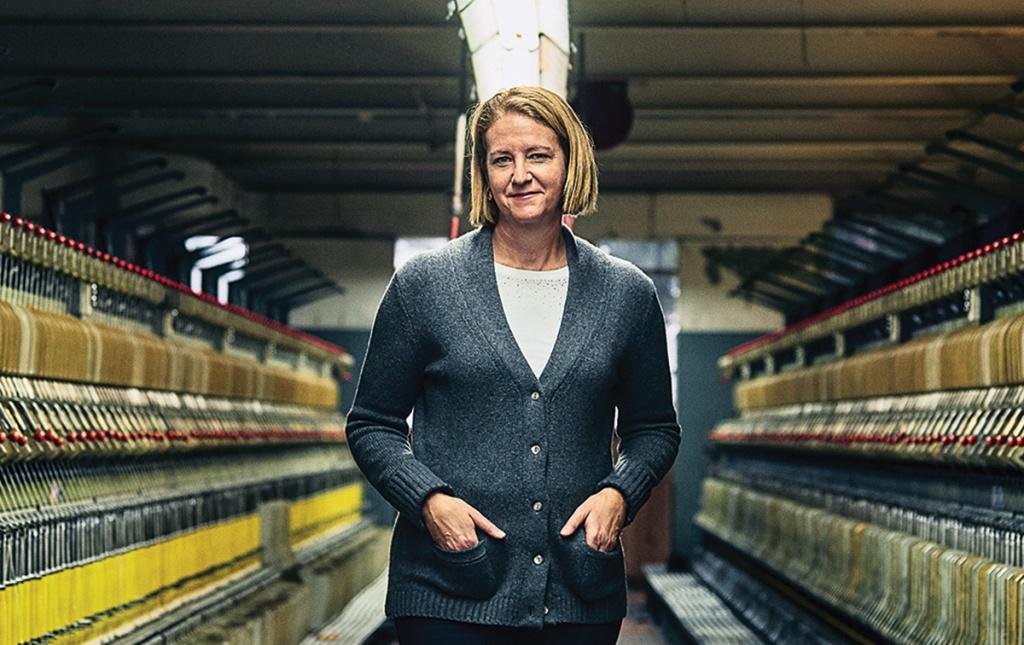 Jennifer Knight '89 stands between woolen spinning frames