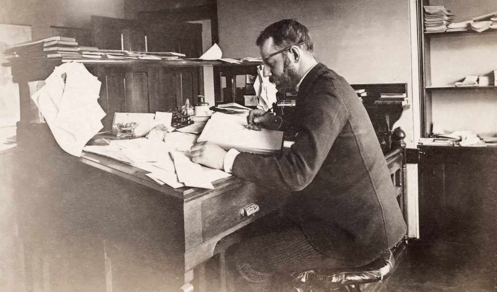 Photo of Gilman P. Robinson at his registrar desk