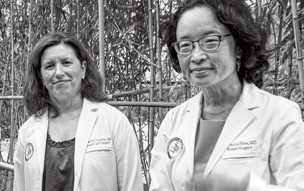 Candid photo of Elizabeth Cureton '95, and Veronica Shim '95 MD