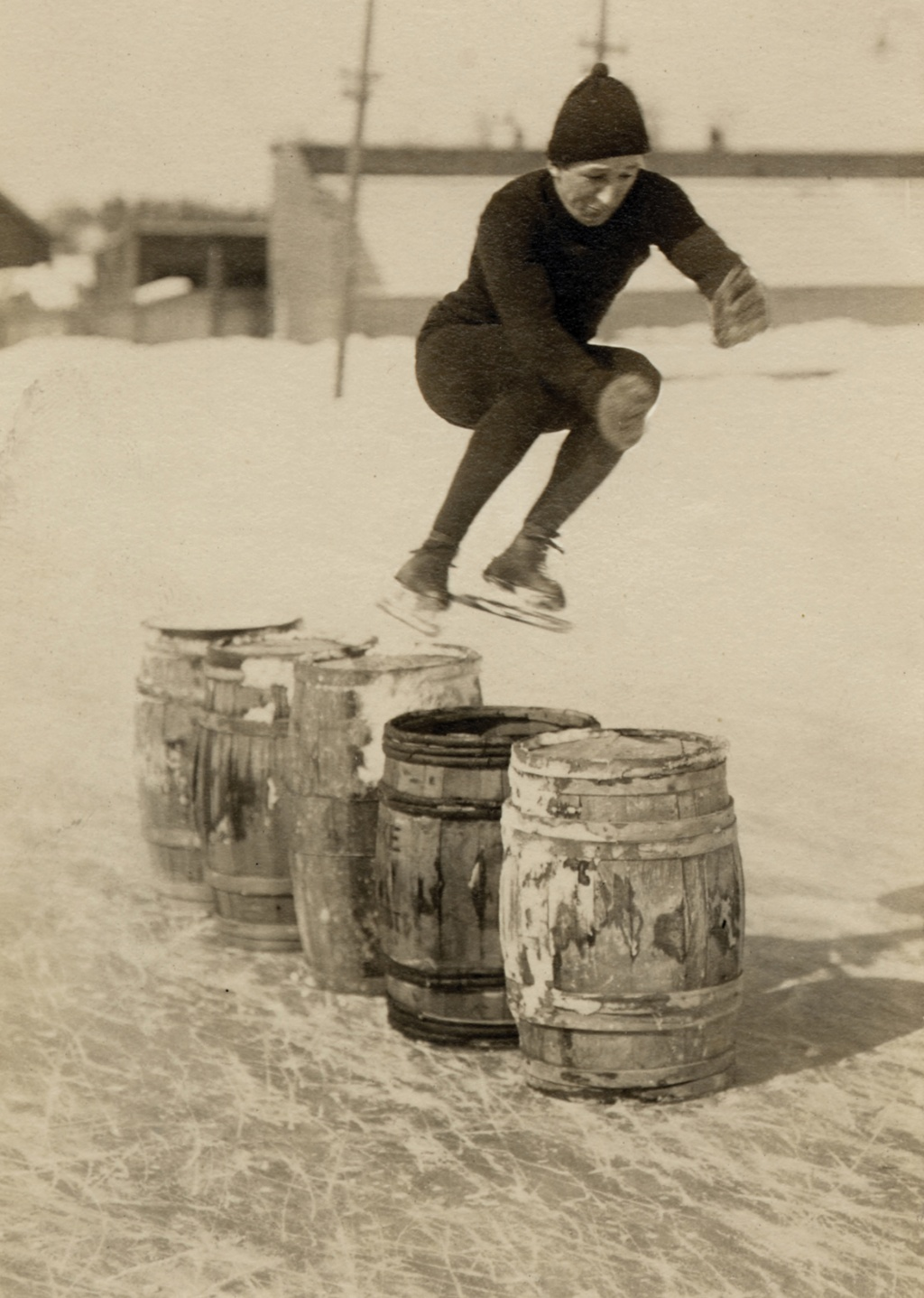 vintage pic of a speed skater jumping barrels