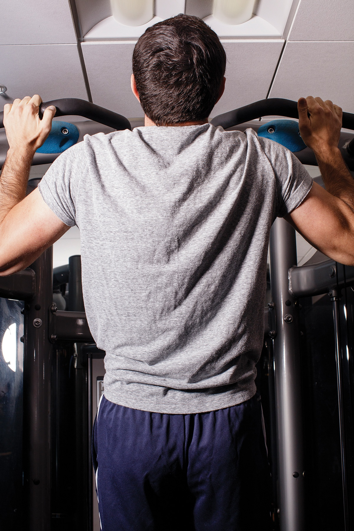 A photograph of Max Deutsch completing a pull-up.
