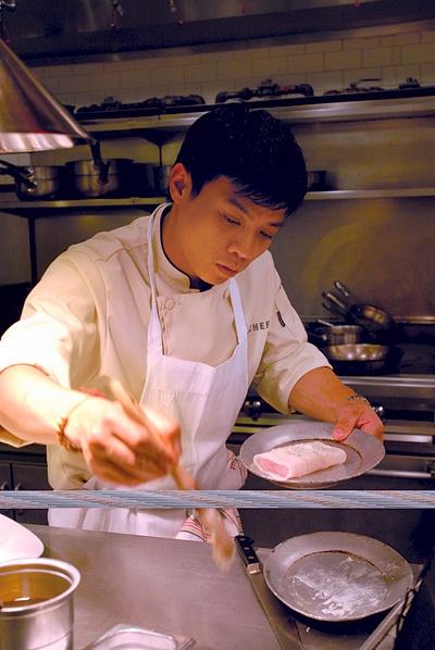 Photo of a chef preparing food.