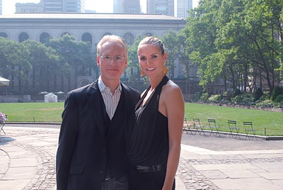 Photo of Tim Gunn and Heidi Klum looking at the camera.