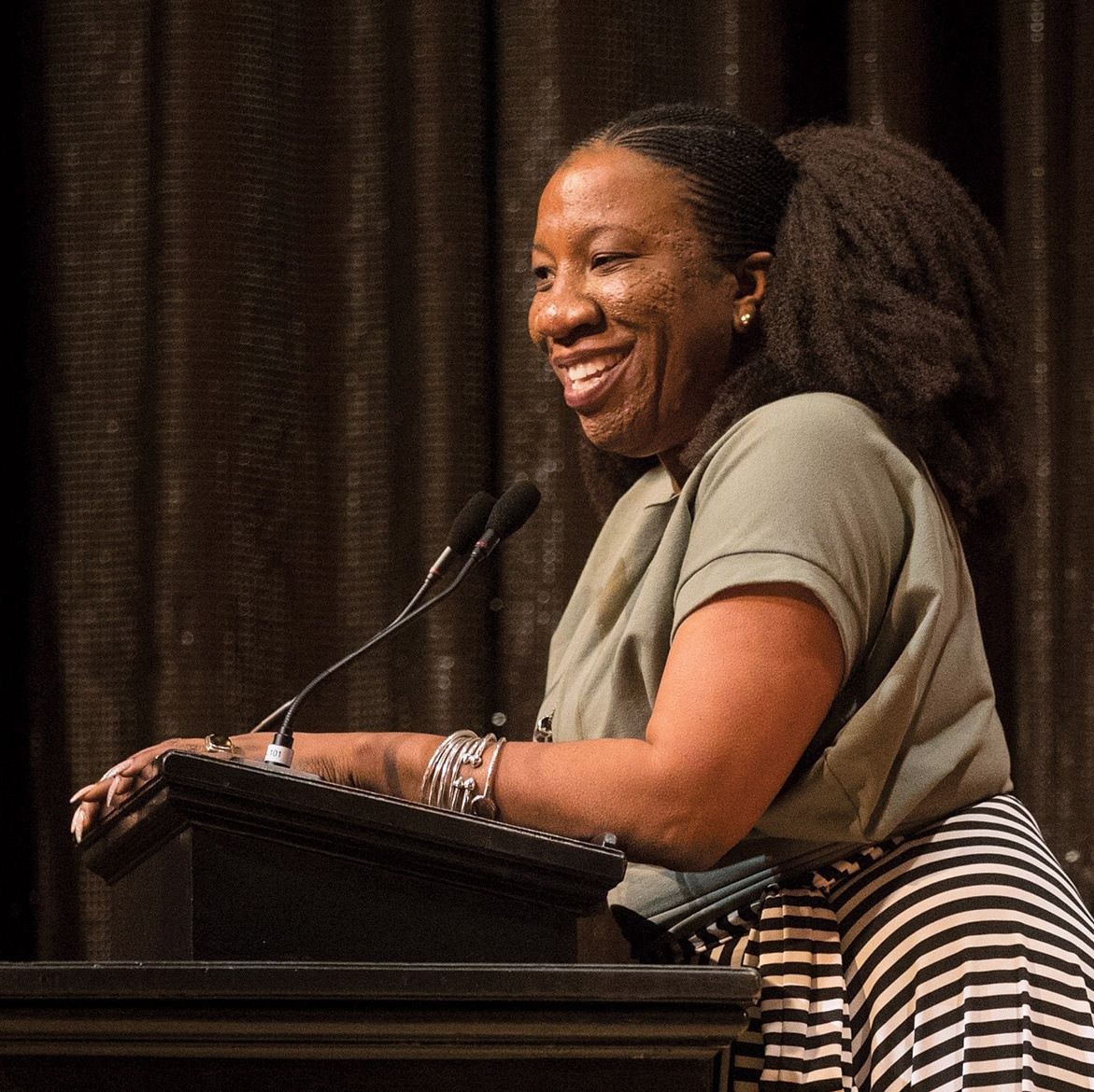 Tarana Burke stands at a podium