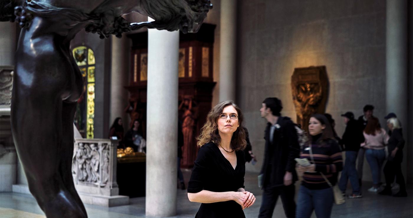 Photo of Madeline Miller, perusing antiquities at New York's Metropolitan Museum.