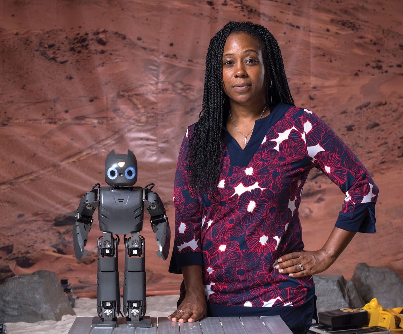 Photo of Ayanna Howard with a robot