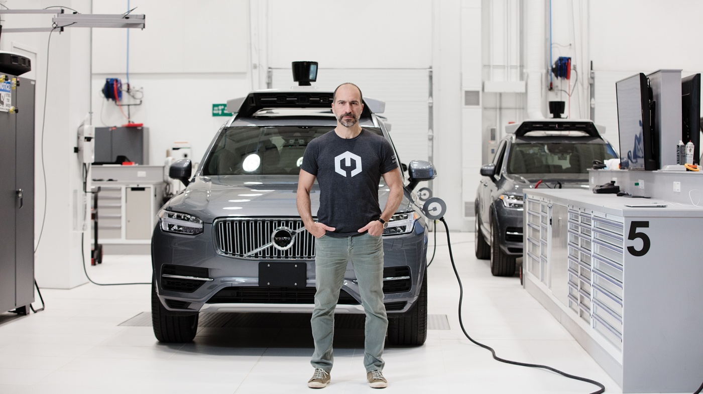 Photo of Dara Khosrowshahi in front of a self-driving car