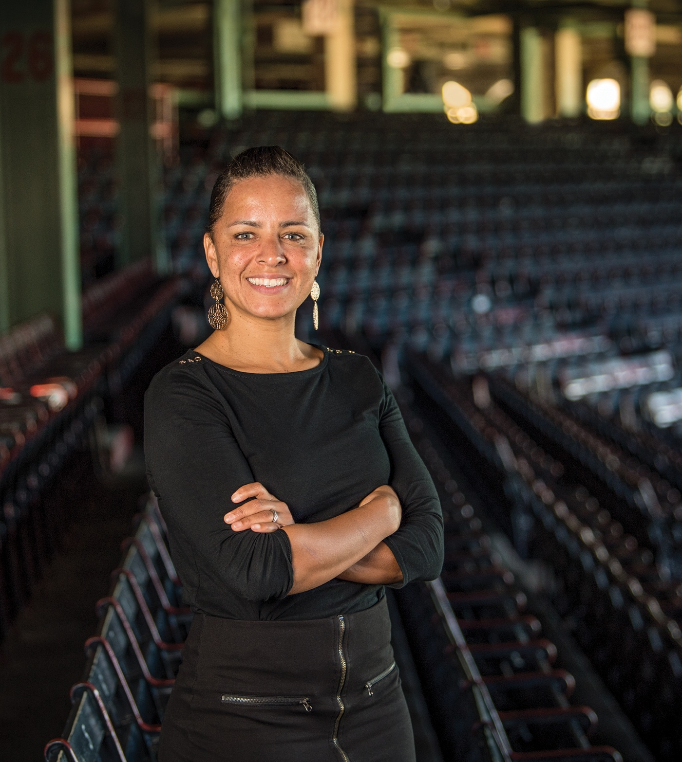 Photograph of Rebekah Splaine Salwasser '01 standing in the Boston Red Sox stadium
