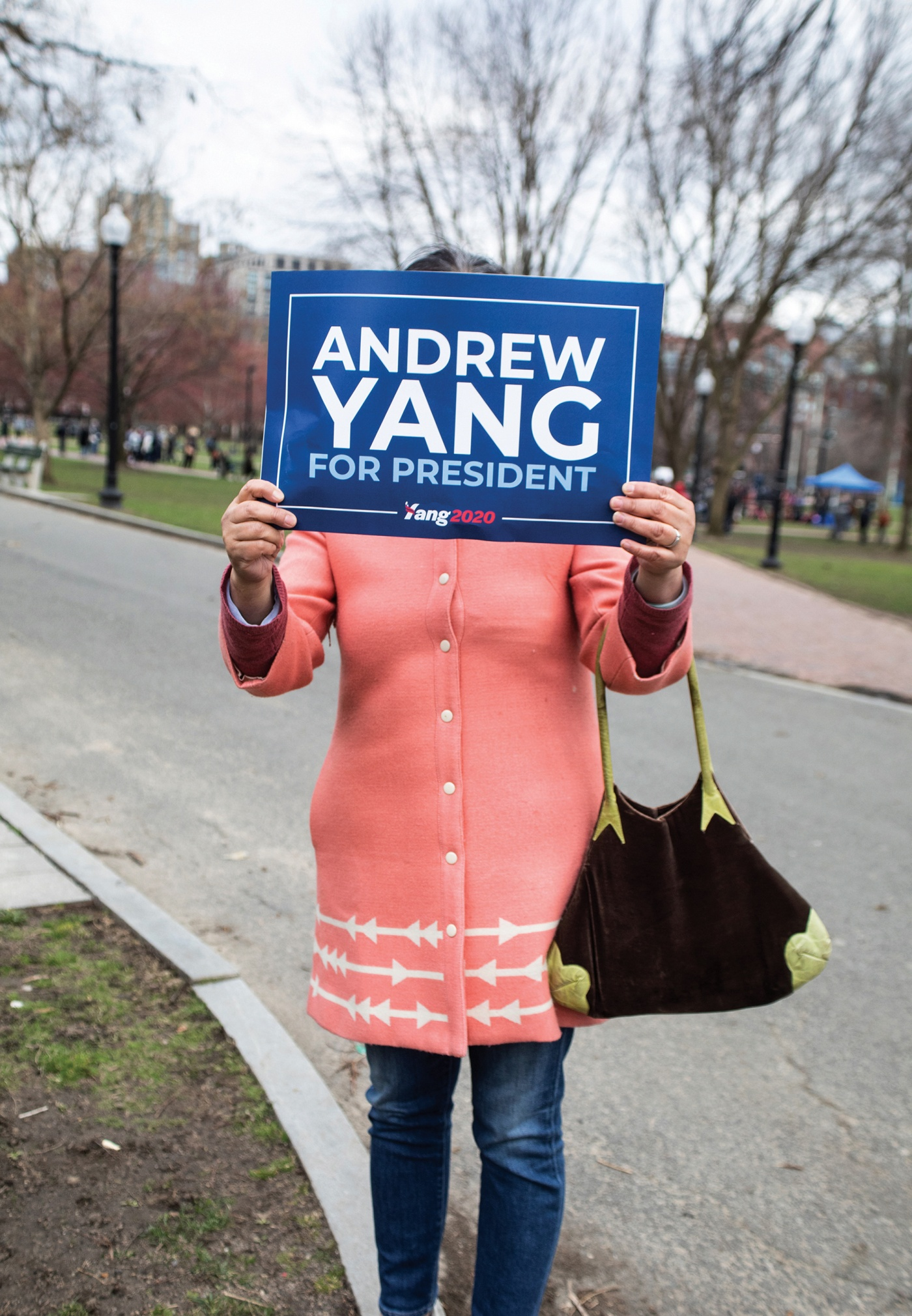A Yang supporter holds a sign
