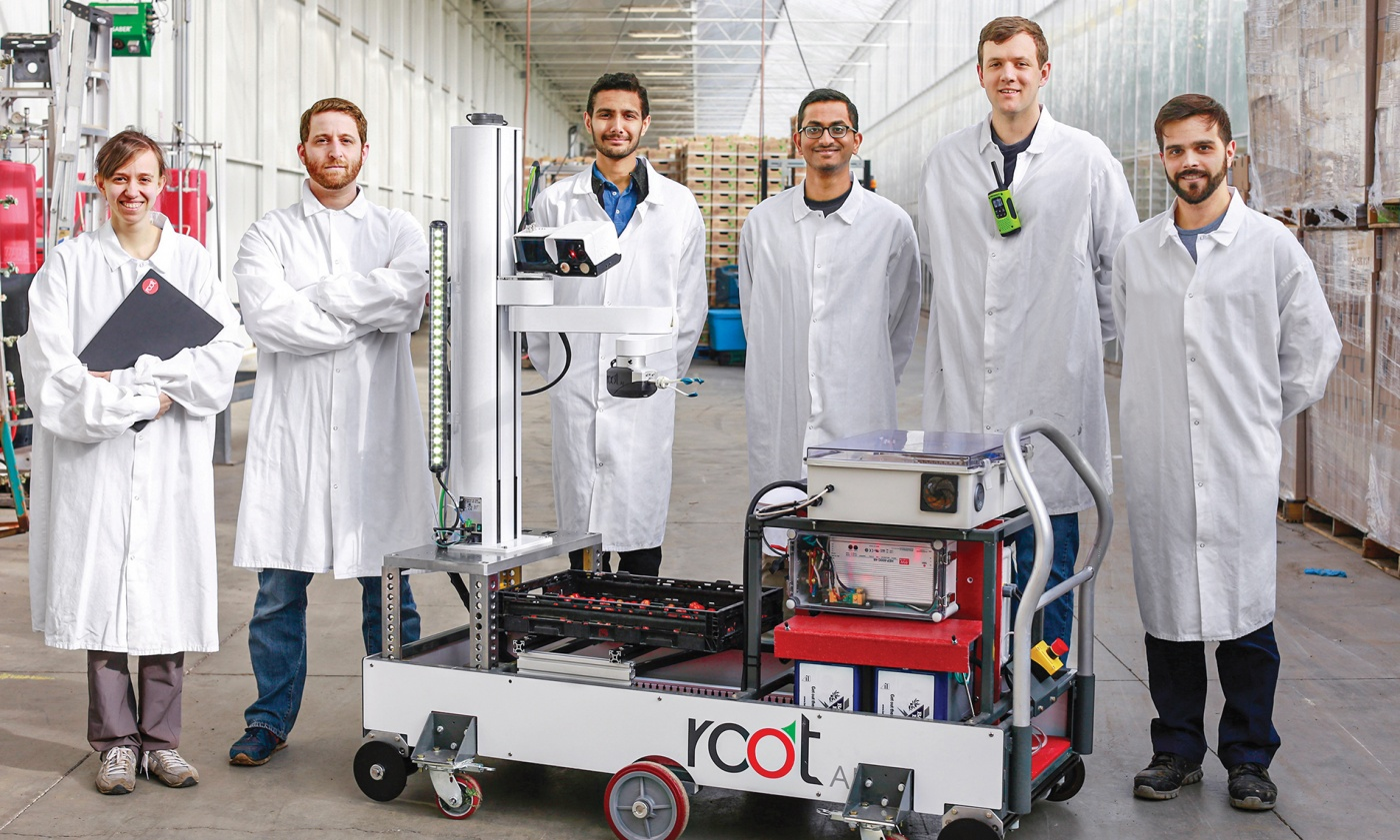 The Root AI team displays their agricultural machinery