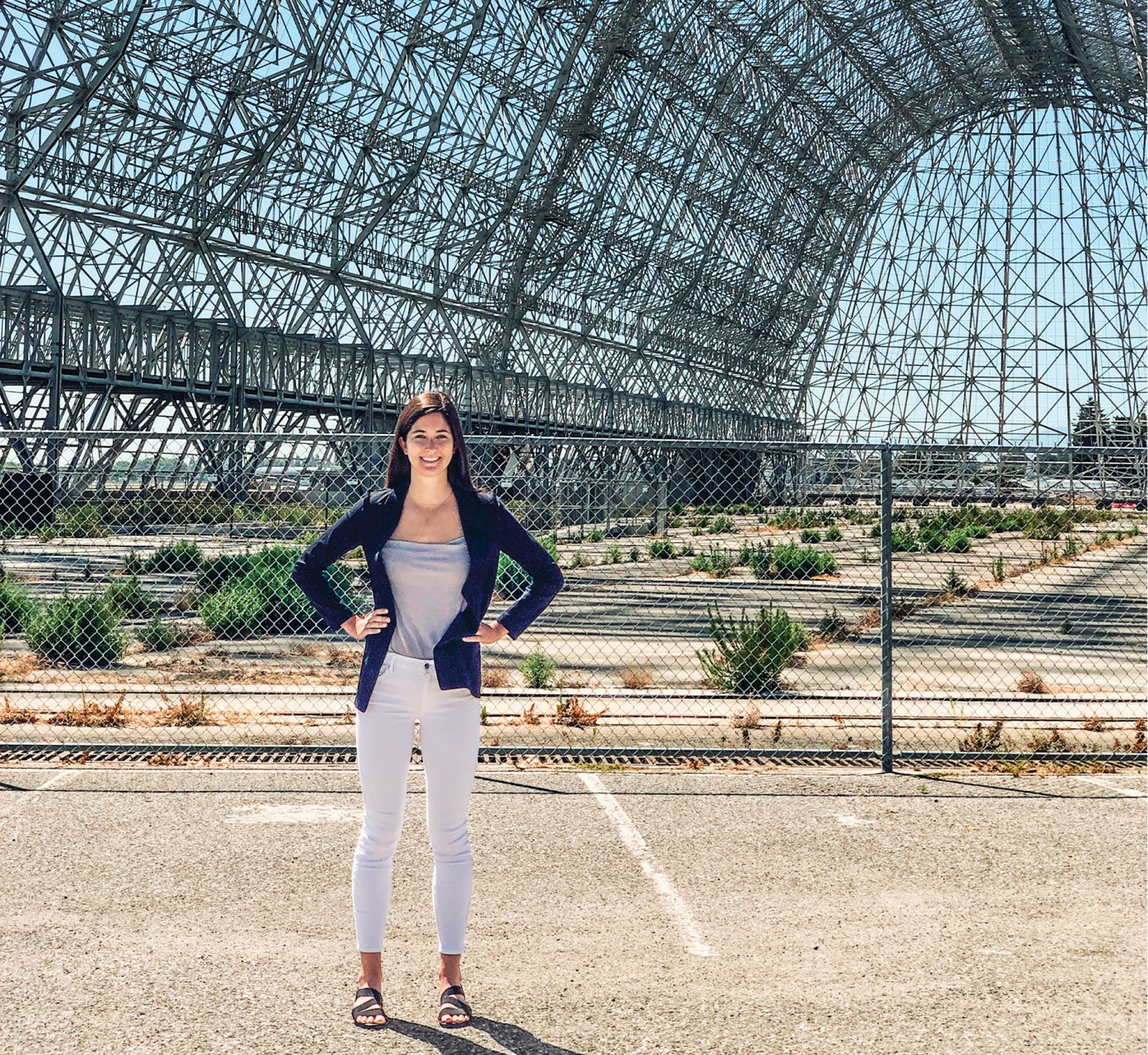 Ariel Deutsch standing outside an old NASA hangar