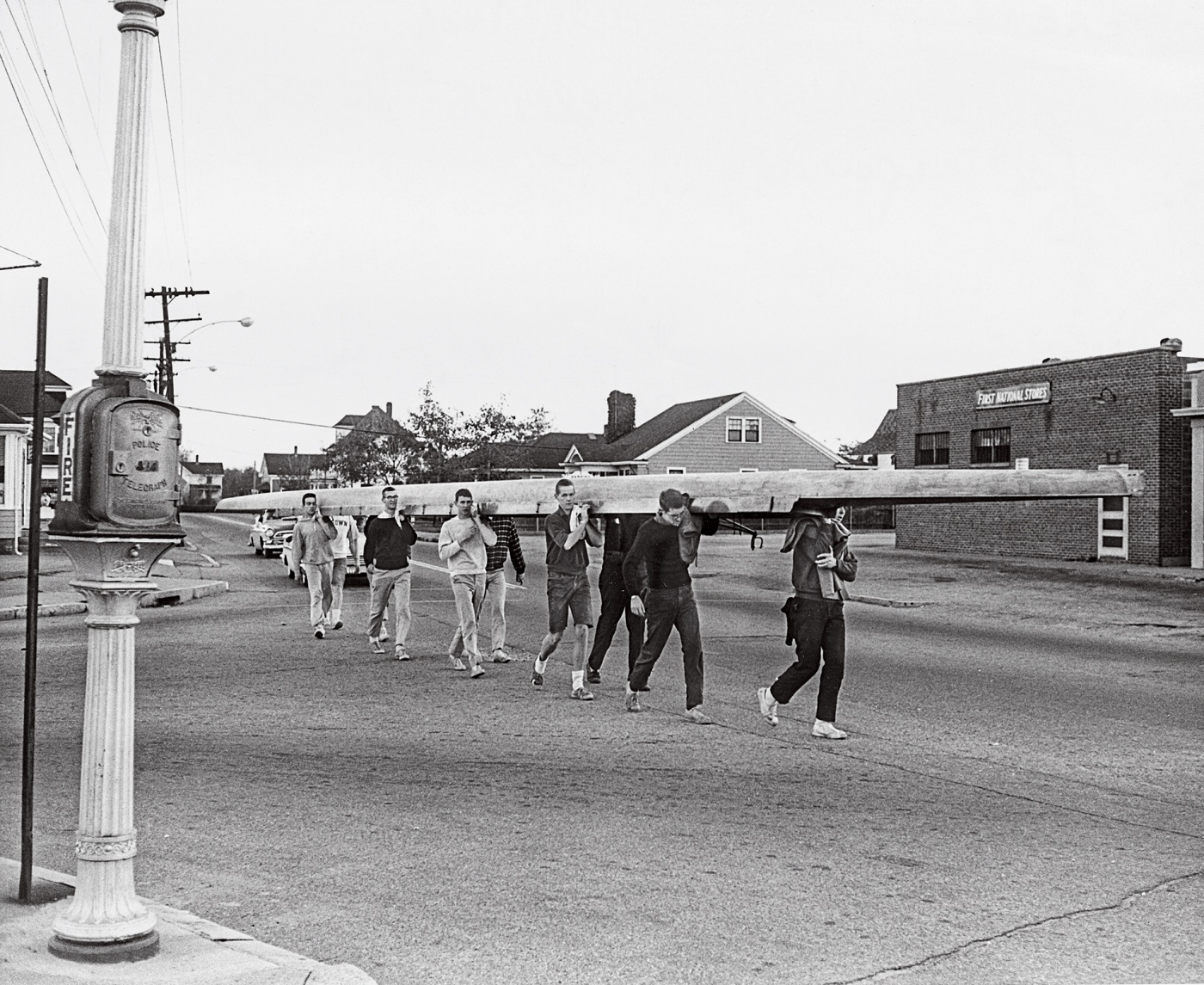 1960 crew carrying shell on street