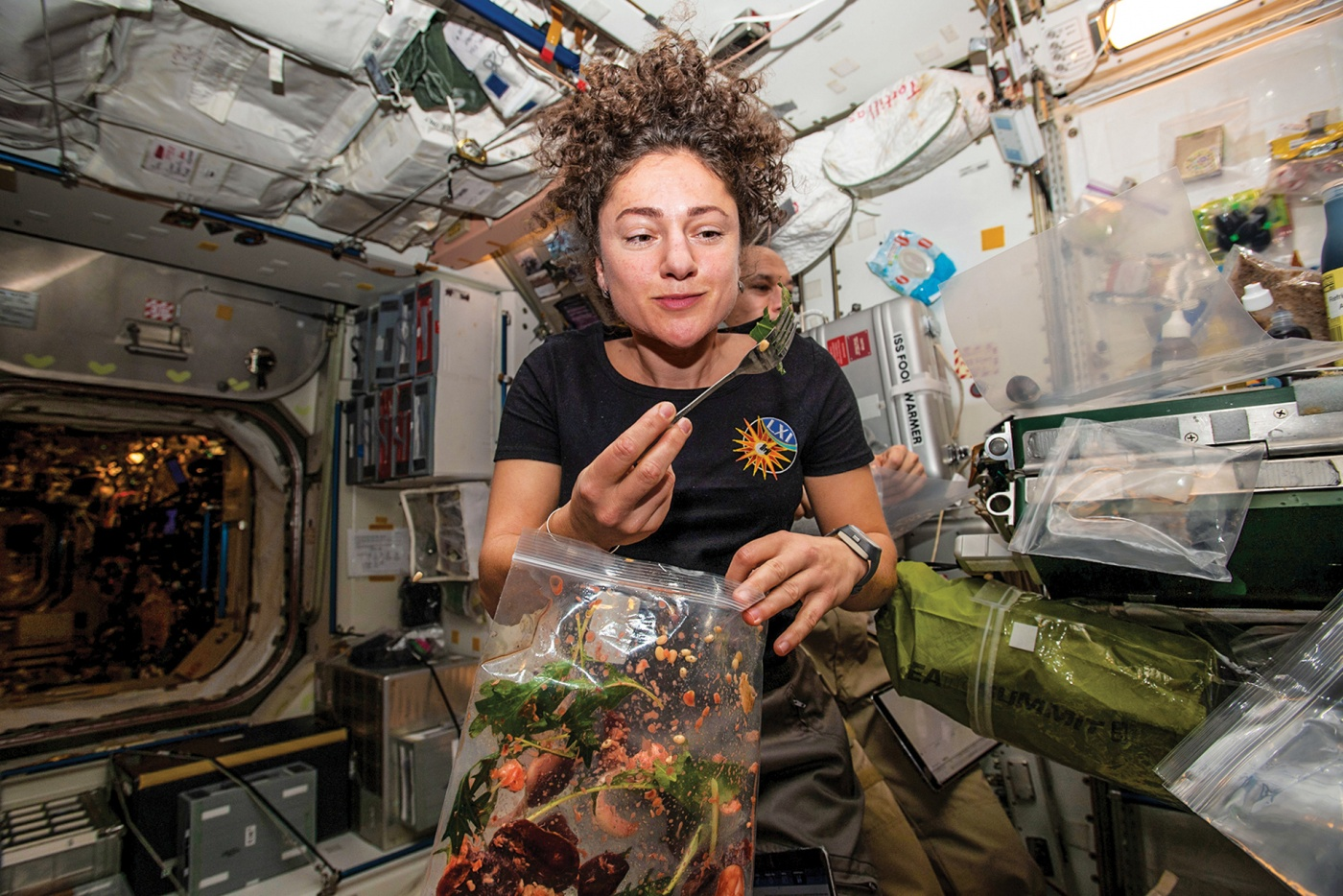 Meir dines on fresh ISS-grown mustard greens
