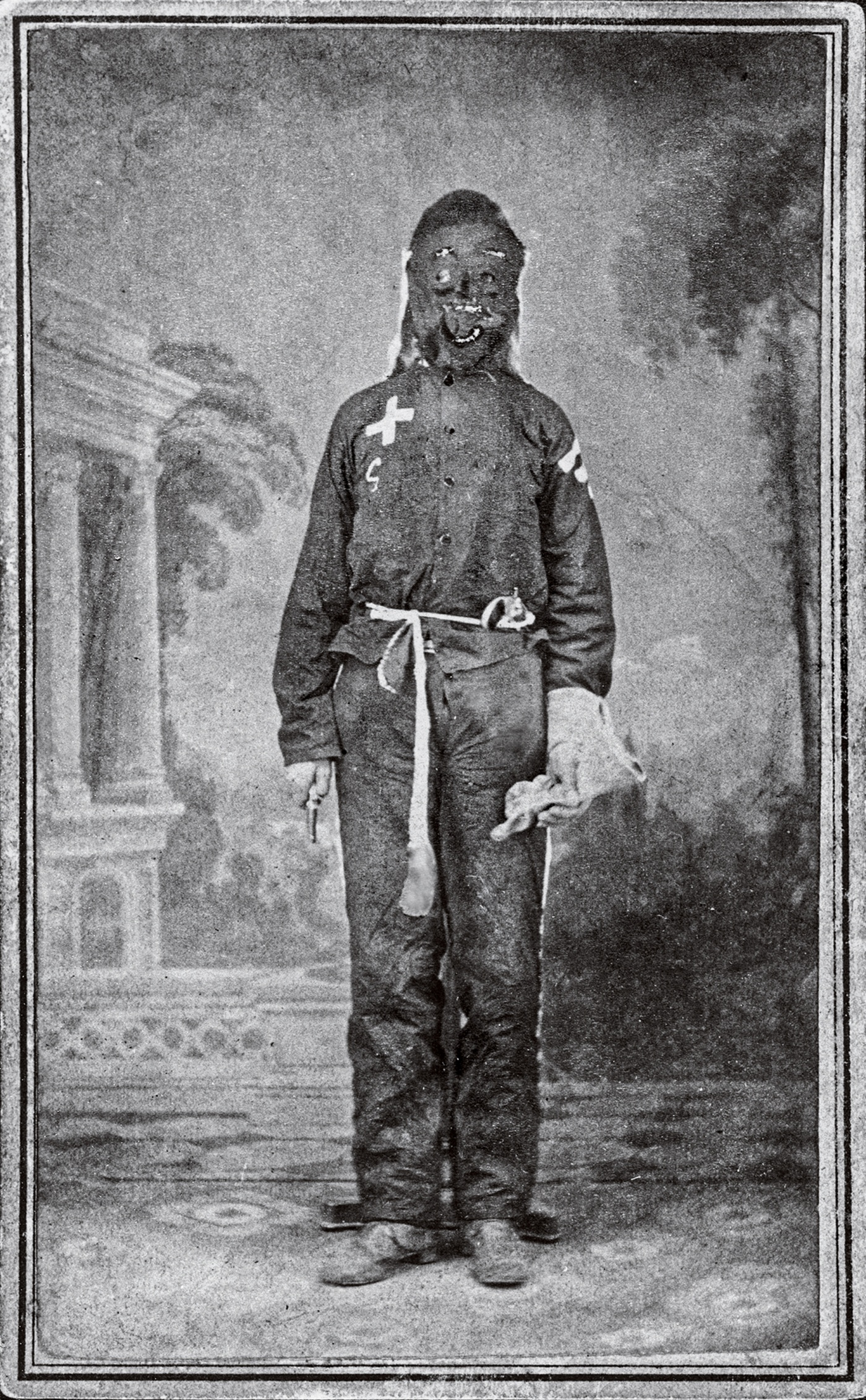 "An 1871 carte de visite—a ""calling card"" photo—of a Klansman"