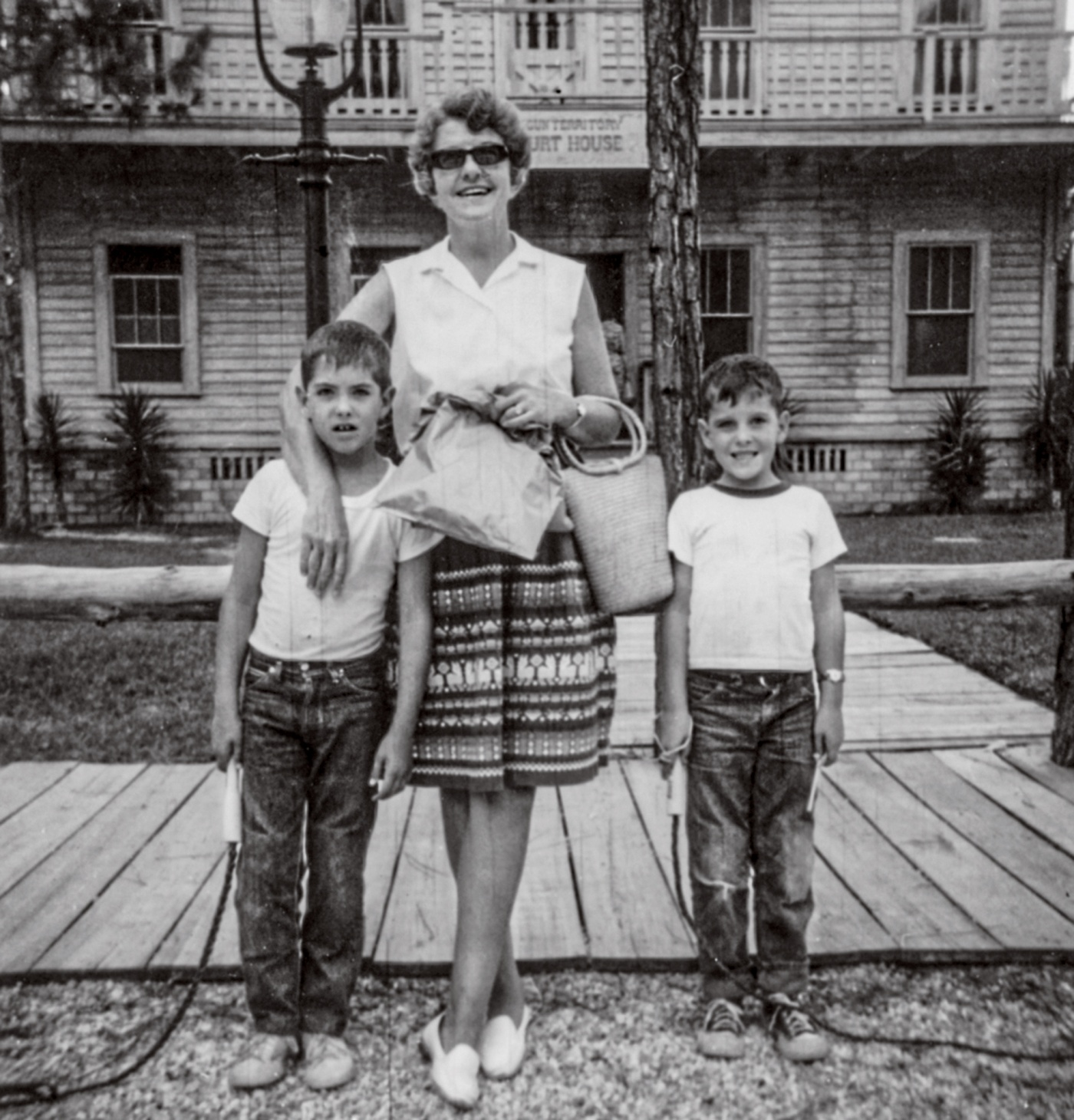 Ball (right) and brother Theodore with their mother Janet in 1966.