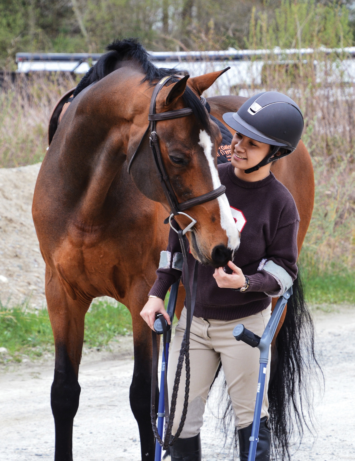 Equestrienne Lauren Reischer '21 with her horse