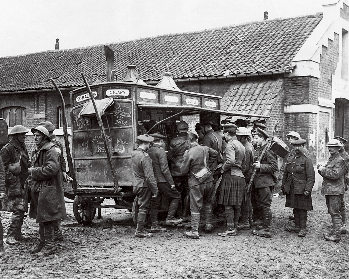 Soldiers gather at a coffee and cigarettes wagon