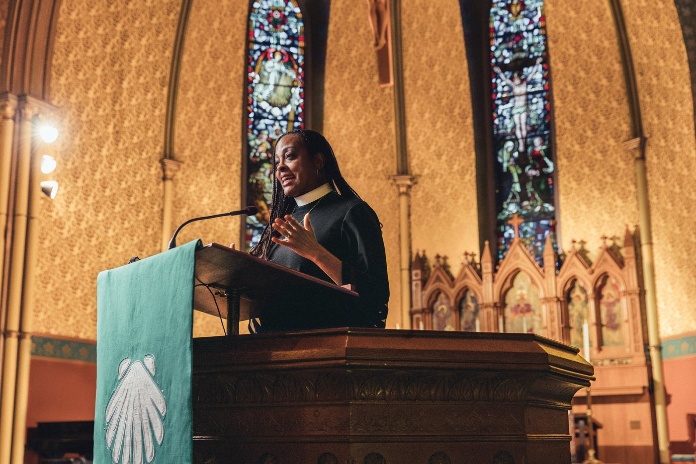 Image of Paula Clark at the pulpit of St. James Cathedral