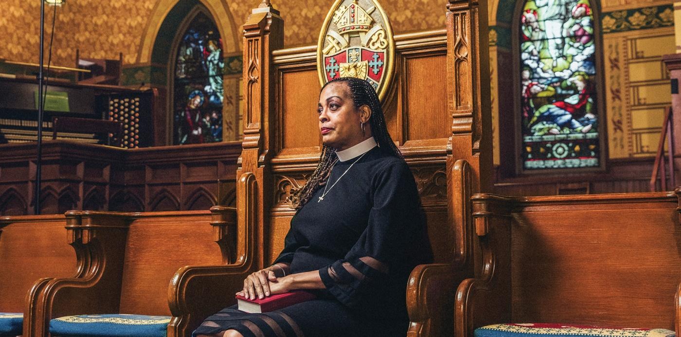 Image of Paula Clark sitting with Bible