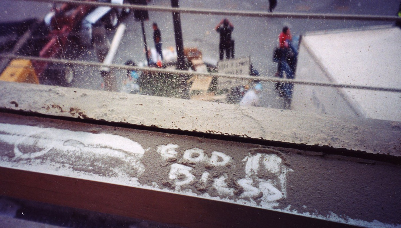 """Image of the words """"God Bless"""" written in ash during 9/11"""