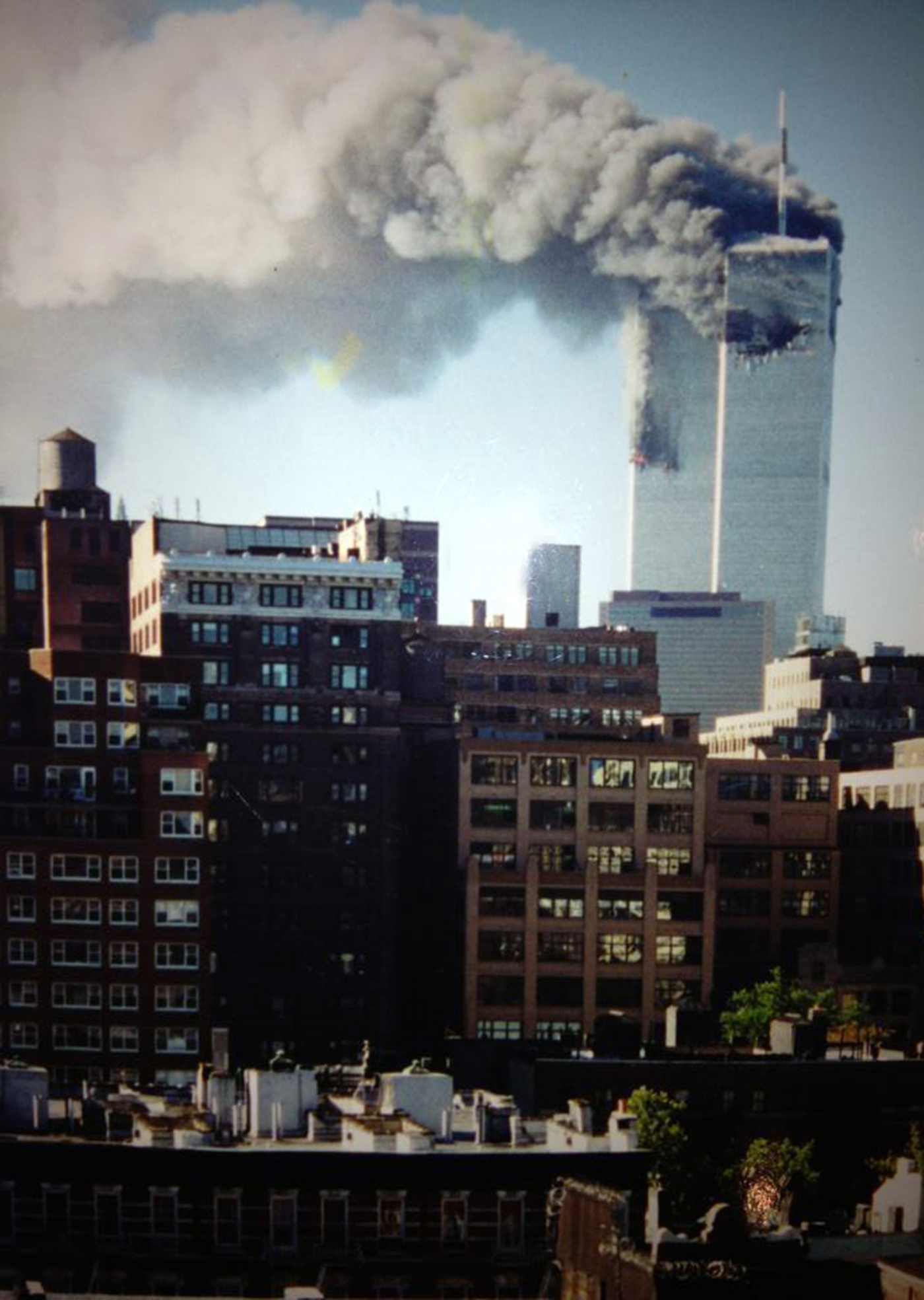 Image of the world trade center towers burning on 9/11