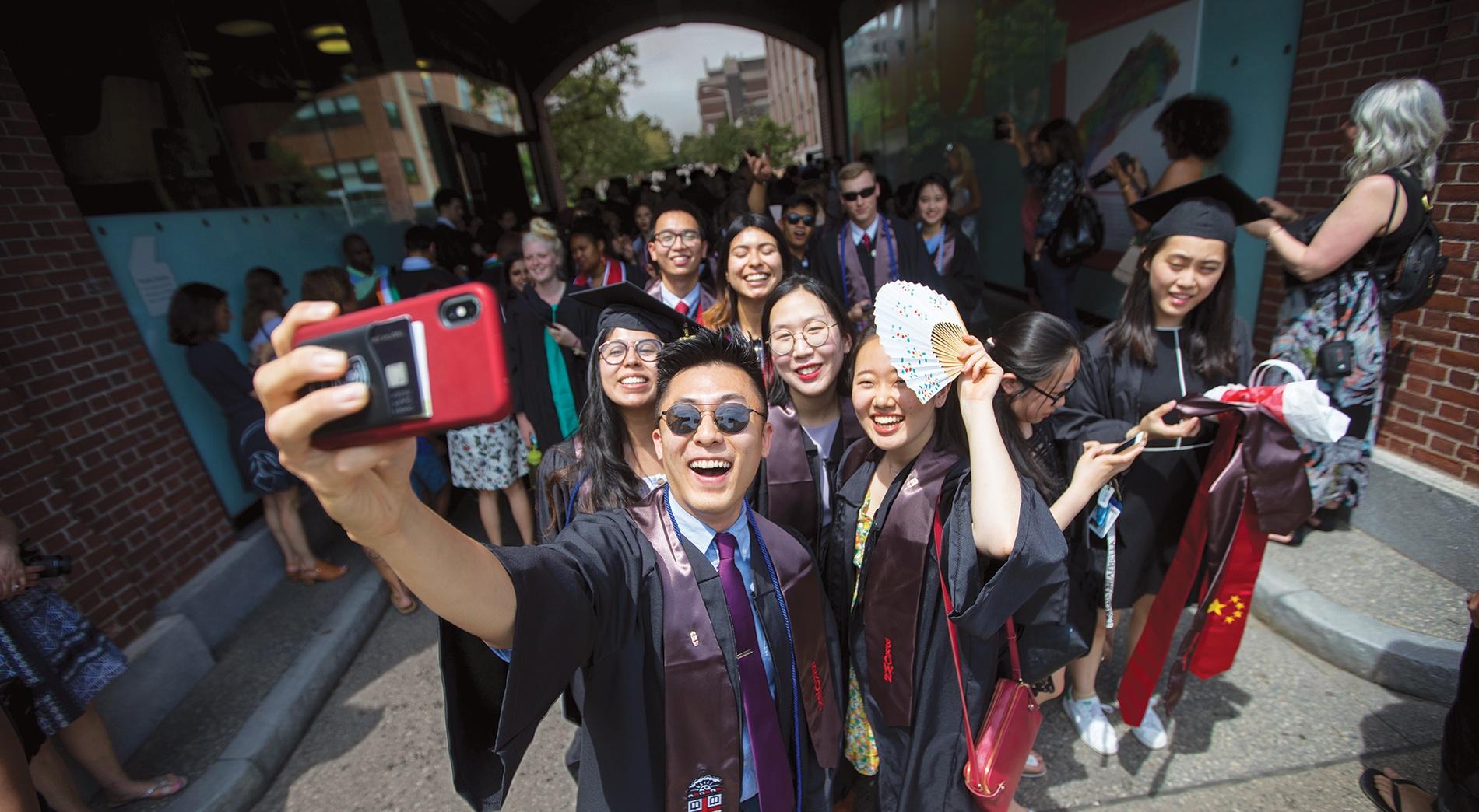 Graduating seniors taking a selfie.