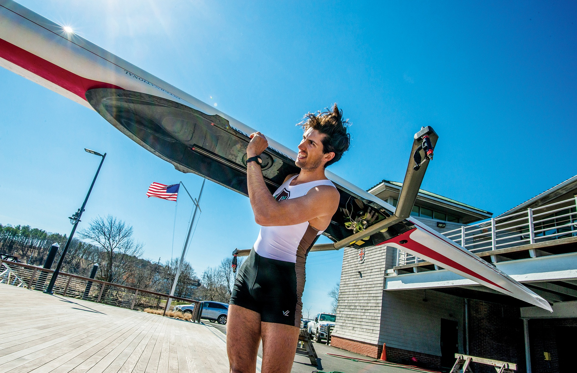 Photograph of Alex Miklasevich '19 holding a crew boat