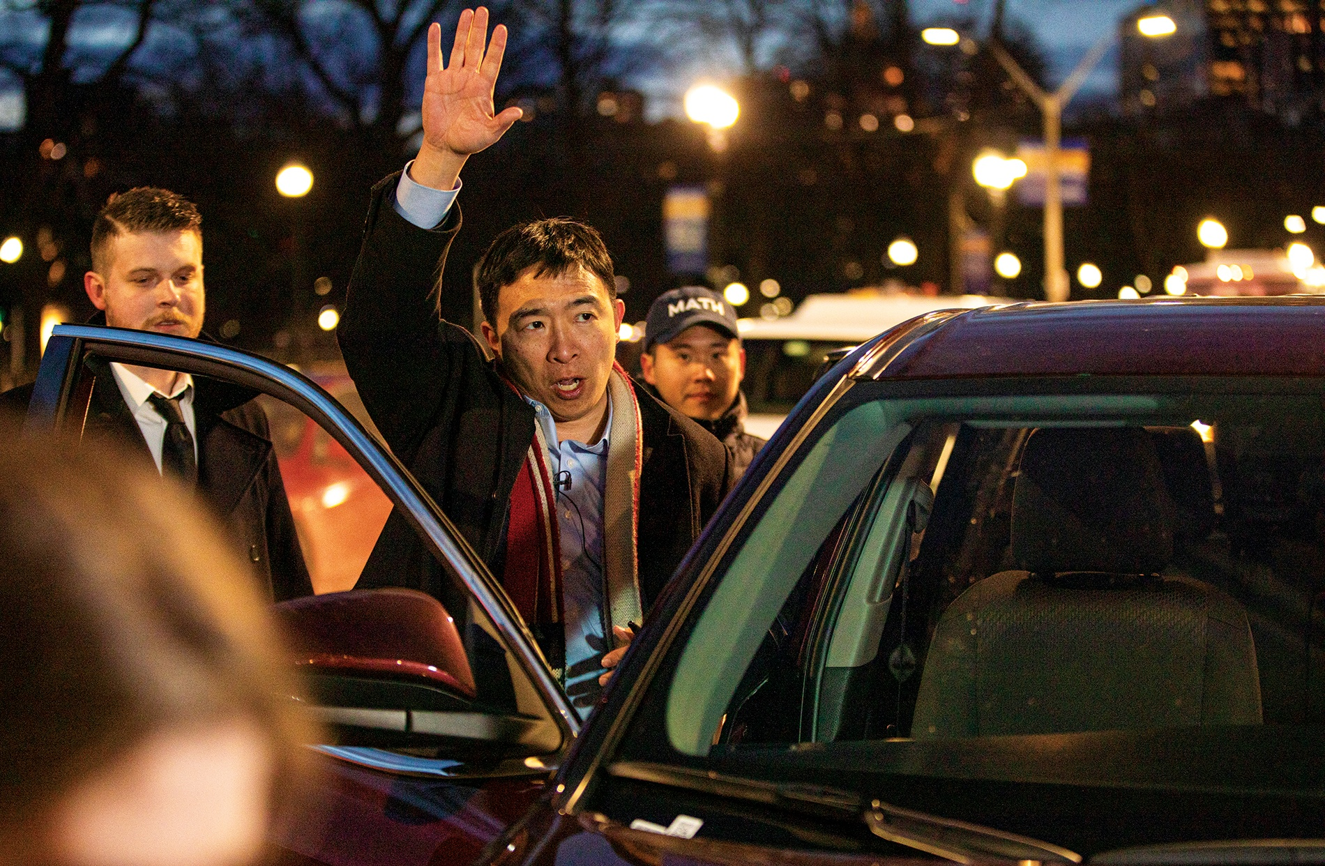 Andrew Yang arrives at a campaign rally