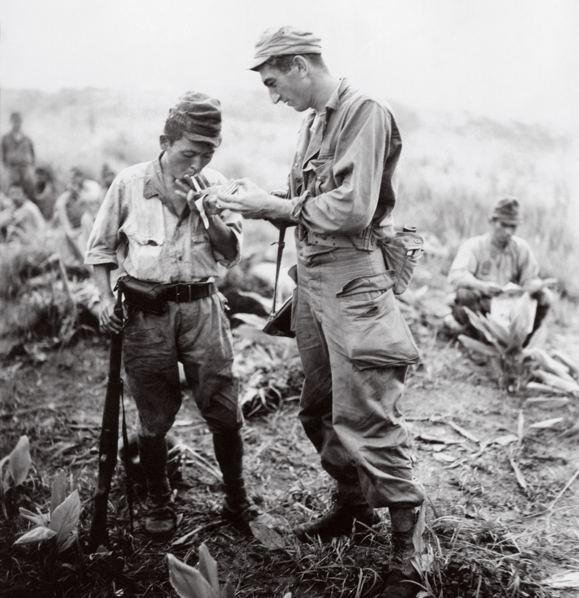 An American soldier lights the cigarette of a Japanese prisoner