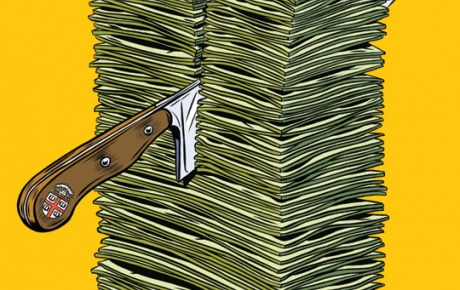 Knife cutting through a pile of money