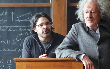 Photograph of Ken Biller '86 with actor Geoffrey Rush (as Albert Einstein) on set
