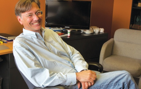 Photograph of Mark Putnam '86 sitting at his desk