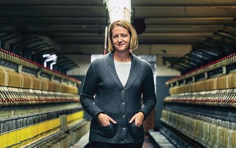 Jennifer Knight '89 stands between woolen spinning frames