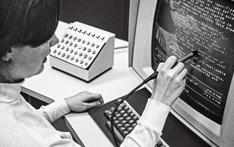 In a vintage photo, Christine Braun '70 works with a light pen