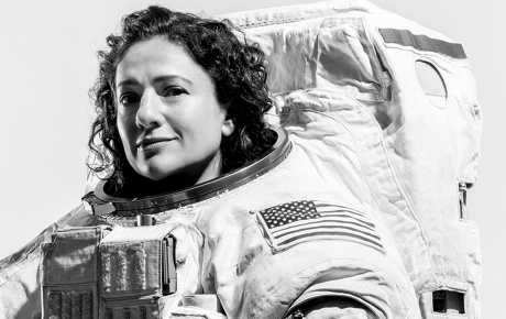 Jessica Meir '99 poses in her spacesuit