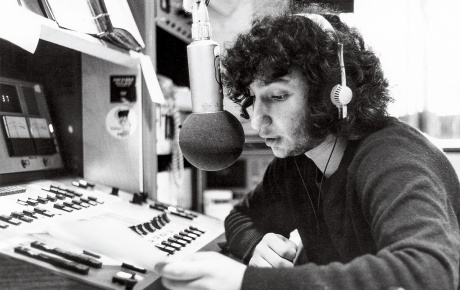 Photo of Bill Lichtenstein on the air at WBCN in 1973