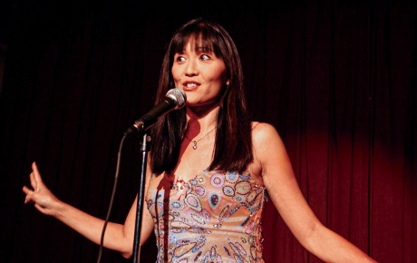 Suzanne Whang '86 ScM photo doing standup comedy