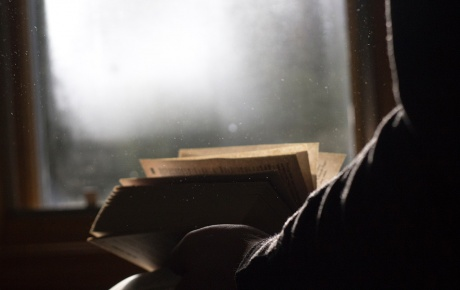 Image of person reading a book by Steve Halama