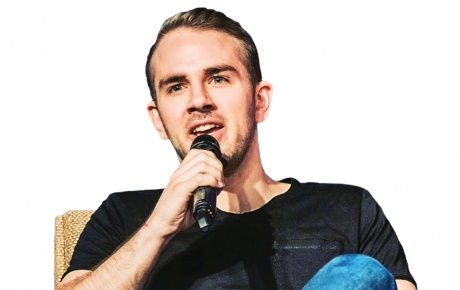Image of Devin Finzer with microphone